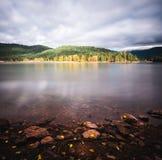 A beautiful California lake reflecting fall colors royalty free stock photos