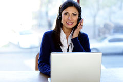 beautiful call-center assistant at the desk Royalty Free Stock Images