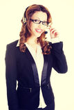 Beautiful call-center assistant smiling Stock Photography
