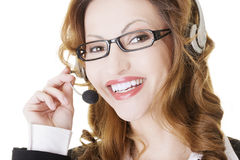 Beautiful call-center assistant smiling Stock Images