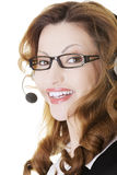 Beautiful call-center assistant smiling Royalty Free Stock Photography