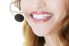 Beautiful call-center assistant smiling Stock Photo