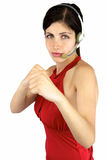 Beautiful call center girl ready to fight. Call center girl with fist up ready to punch and fight royalty free stock images