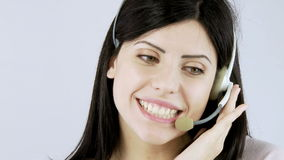 Beautiful call center girl talking on the phone with headset stock video footage