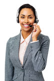 Beautiful Call Center Representative Wearing Headset. Portrait of beautiful call center representative wearing headset over white background. Vertical shot Stock Photo