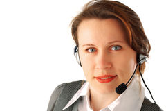 Beautiful call centre executive. Closeup portrait of a young business woman with headset, isolated over white background Royalty Free Stock Images