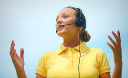 Beautiful call centre operator or client services office trying. To explain something to a client over the microphone of her headset stock images