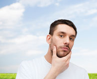 Beautiful calm man touching his face Royalty Free Stock Photo
