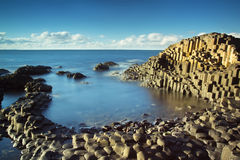 Beautiful calm sunny afternoon at the famous Giant's Causeway. Beautiful, calm, sunny afternoon at the famous Giant's Causeway on the Antrim Coast of Northern Stock Photos