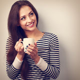 Beautiful calm thinking woman drinking hot coffee from cup. Vint Stock Photography