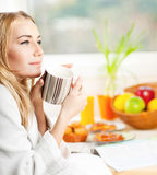 Beautiful calm young woman having morning coffee Stock Images