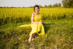Beautiful Cambodian Asian Bride in Traditional Wedding Dress in a Rice Field Stock Photos