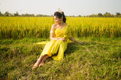 Beautiful Cambodian Asian Bride in Traditional Wedding Dress in a Rice Field Royalty Free Stock Photo