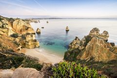 Beautiful Camilo Beach before sunrise, Lagos, Algarve, Portugal. Beautiful Camilo Beach with cliffs and arches in the morning, Lagos, Algarve, Portugal Royalty Free Stock Photo