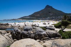 Beautiful Camps Bay beach and Lions Head Mountain peak. stock photography