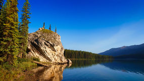Beautiful Canadian mountain lake at dawn. Morning mood by the lake as seen in the wilderness of Banff National Park, Alberta, Canada stock photos
