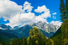 Beautiful Canadian Rockies. Fluffy clouds over Canadian Rockies stock photography