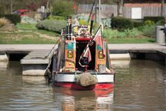 Beautiful canal narrow boat seen from the stern Stock Photo
