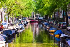 Beautiful canal in the old city of Amsterdam Stock Images