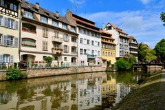 Beautiful canals with reflections, Strasbourg, France. Picturesque canal houses with reflection in the Petite France neighborhood of Strasbourg Stock Photography