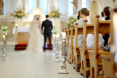 Beautiful candle wedding decoration in a church. During wedding ceremony Royalty Free Stock Images