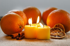 Beautiful candles and juicy oranges Royalty Free Stock Photography