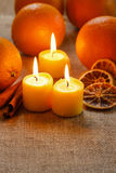 Beautiful candles and juicy oranges Royalty Free Stock Photos