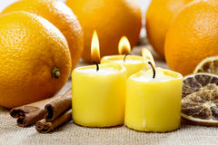 Beautiful candles and juicy oranges Royalty Free Stock Photo