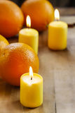 Beautiful candles and juicy oranges Royalty Free Stock Images