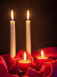 Beautiful candles on red cloth Stock Photo