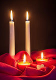 Beautiful candles on red cloth Royalty Free Stock Photo