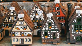 Beautiful candlesticks in form of houses in the style of fachwerk. National German and Dutch white with black beams mini. Beautiful candlesticks in the form of stock footage