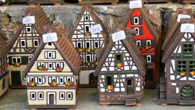 Beautiful candlesticks in form of houses in the style of fachwerk. National German and Dutch white with black beams mini. Beautiful candlesticks in the form of stock video
