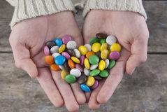 Beautiful candy in palms. Close up photo Stock Image