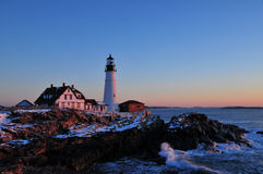 Cape Elizabeth Lighthouse at Sunrise. The beautiful Cape Elizabeth Lighthouse at sunrise with crashing surf on the rocks during a winter sunrise Stock Images