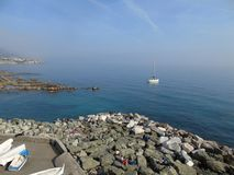 Genova in summer days with some people enjoying the evening. Beautiful caption of an amazing calm sea from Genova in summer days with some people enjoying the Royalty Free Stock Image