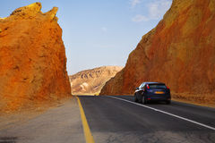 The beautiful car on highway in stone desert Stock Photos