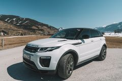 Beautiful car SUV in the nature deep in Alps. Latest brand new white 2018 Range Rover Evoque. Range Rover bestselling model in the wild royalty free stock photos