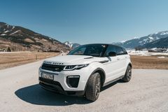 Beautiful car SUV in the nature deep in Alps. Latest brand new white 2018 Range Rover Evoque. Range Rover bestselling model in the wild stock photos