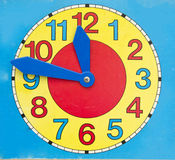 Beautiful cardboard clock toy. For education Royalty Free Stock Photo