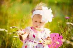 Beautiful carefree girl playing outdoors in field with high gree stock photos