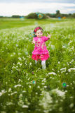 Beautiful carefree girl playing outdoors in field Stock Photography