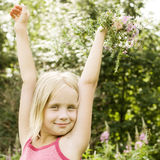 Beautiful carefree teenage girl with flowers Royalty Free Stock Photo