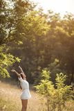 Beautiful carefree woman in fields being happy outdoors royalty free stock photos