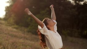 Beautiful carefree woman in fields being happy outdoors stock footage
