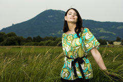 Beautiful carefree young woman enjoying nature Stock Photography
