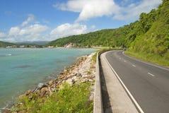 Beautiful caribbean coastal highway road. With blue bay Royalty Free Stock Photo