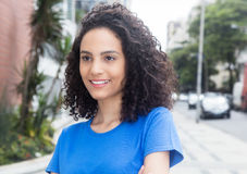 Beautiful caribbean woman with blue shirt in the city Royalty Free Stock Photos