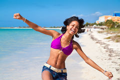 Beautiful caribbean woman dancing. On the tropical beach Royalty Free Stock Image