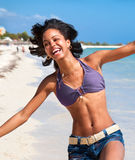 Beautiful caribbean woman dancing. On the tropical beach Stock Image